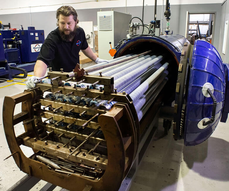 Industrial rubber roller manufacturing and refurbishment